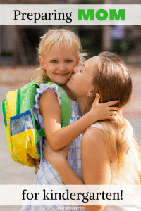 mom kissing school girl goodbye
