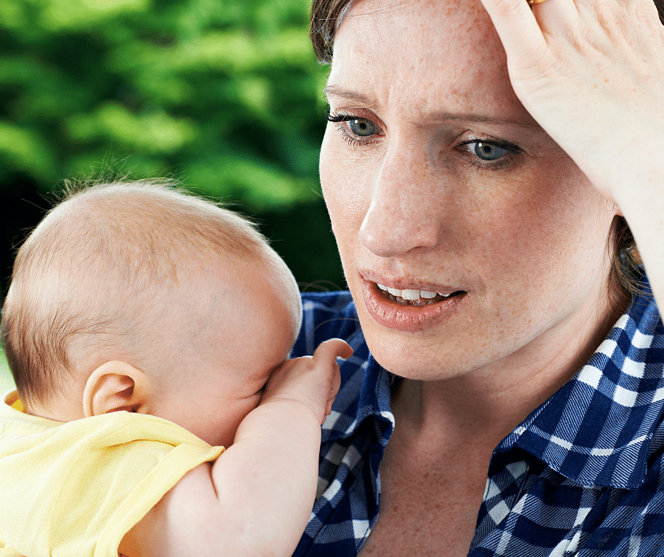 Forgetful Mom holding baby trying to beat mom brain